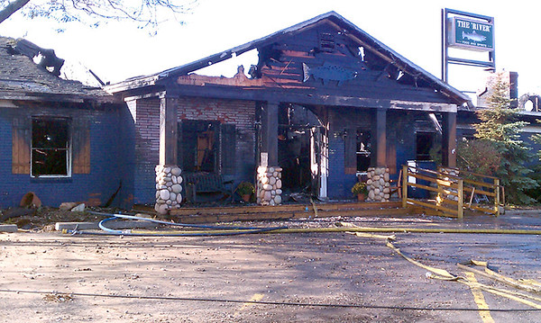 Record-Eagle/James Russell<br /> The Riverwalk Grill in Elk Rapids was destroyed Sunday.