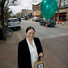 Record-Eagle/Keith King<br /> Colleen Paveglio, marketing director with the Traverse City Downtown Development Authority and Downtown Traverse City Association, holds a bag and balloon like the ones that will be placed in front of the stores that will be participating in Shop Your Community Day on November 12.