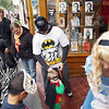 Record-Eagle/Keith King<br /> Chris Loomis, of Traverse City, walks with his son, Ian Loomis, 23 months, as the two participate in the Downtown Halloween Walk Friday, October 28, 2011 dressed as Batman and Robin.