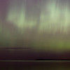 Record-Eagle/Jan-Michael Stump<br /> The northern lights shine over West Grand Traverse Bay on Monday night. The lights, also known as aurora borealis, are caused by charged particles from the sun entering the Earth's atmosphere.