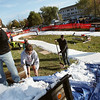 Record-Eagle/Keith King<br /> Matt Durand, left, of Interlochen; Glenn Goodman, of Bellaire; and Yersen Schwab, of Williamsburg, shovel ice from local ice rinks to get the course ready for the second annual Nordic Fest, which was the 2011-2012 race season opener for U.S.A., Nordic and Michigan Cup cross-country skiing.