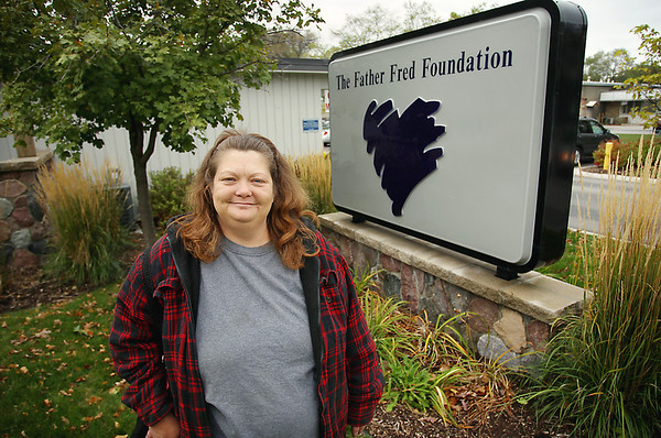 Record-Eagle/Keith King<br /> Father Fred provided Cheryl Brown, of Elk Rapids, with financial assistance to help pay her utility bills.
