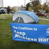 Record-Eagle/Keith King<br /> A sign for the Coalition to Keep Michigan Warm is displayed outside the Plante and Moran building Tuesday, during a sleep out to raise awareness of the need for home heating assistance for some northern Michigan families.