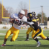 Record-Eagle/Keith King<br /> Traverse City Central's Dylan Kelly works to bring down Menominee's Connor LaPlante at Thirlby Field.