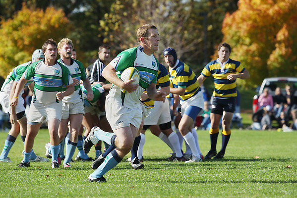 Record-Eagle/Keith King<br /> Mike Amon, of the Traverse Bay Blues Rugby Football Club, runs against the Michigan Rugby Football Club during the Blues' final home game of the regular season at the Grand Traverse County Civic Center. A collection for food, diapers and toiletries also took place during the game for the club's annual Rugby Gives Back charity drive.