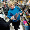 Record-Eagle/Keith King<br /> Cathy Wiesenauer, right, of Traverse City, helps her daughter, Amanda Williams, of Traverse City, and son-in-law, Dustin Williams, find a pirate costume for her grandson, the Williams' son, at the Traverse City Goodwill store.