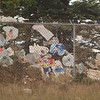 Record-Eagle/Jan-Michael Stump<br /> Wednesday's wind storms blow trash from Glens Landfill in Maple City.