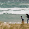 Record-Eagle/Jan-Michael Stump<br /> Jason, left, and Adam Dalgliesh (cq) of Traverse City braved Wednesday's wind storms to check out the waves in Leland.
