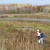 Lindsay VanHulle/Record-Eagle<br /> Steve Rouse, left, and Heather Peyton, volunteers for the Grand Traverse Conservation District, plant new trees near the Lone Pine Trailhead and Boardman River. The goal was to restore native vegetation to the former Boardman Pond.