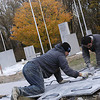 Record-Eagle/Lisa Perkins<br /> Derick Gonzalez and Jorge Vasquez of Rieth-Riley Construction stamp a stone pattern on the concrete walkway that leads to Grand Traverse Area Veterans Memorial Park.