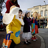 Record-Eagle/Keith King<br /> From left, Ethan Rademacher, 3, dressed as a banana; his sister, Sydney Rademacher, 5, dressed as a bride; and their cousin, Avery Bills, 5, dressed as Supergirl, wait for the light to change at the intersection of Cass and Front streets Friday during the Downtown Halloween Walk.