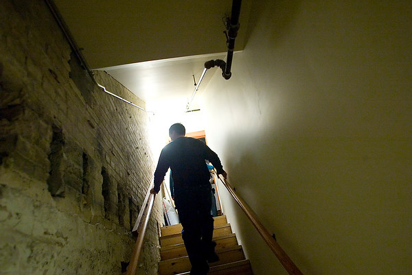 Record-Eagle/Jan-Michael Stump<br /> Darren Zywicki, of Traverse City, walks up stairs from the basement of the City Opera House while on a tour with members of the Michigan Area Paranormal Activity Investigation Team, or M.A.P.I.T., on Monday night. The team recorded evidence last October of voices and a strange shadow and returned this year along with guests who made a donation to the opera house. The teams use equipment such as night-vision cameras and infrared thermometers in their attempts to document paranormal activity.