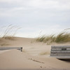 Record-Eagle/Keith King<br /> Strong winds blow sand onto a pair of benches Wednesday, October 27, 2010 near Lake Michigan in Frankfort.