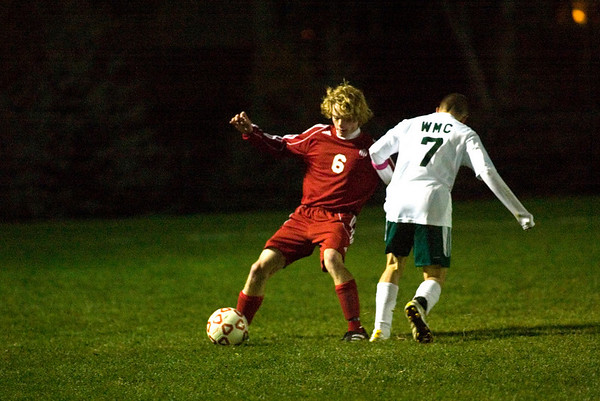 Record-Eagle/Jan-Michael Stump<br /> Suttons Bay's Ryan Hartman (6) dribbles around Muskegon West Michigan Christian's Matt Wisen (7) in the first half of Friday's regional game.