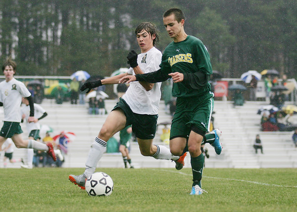 Record-Eagle/Keith King<br /> Traverse City West's Malte Zaumseil, left, and Midland Dow's Jacob Logan hustle for the ball.