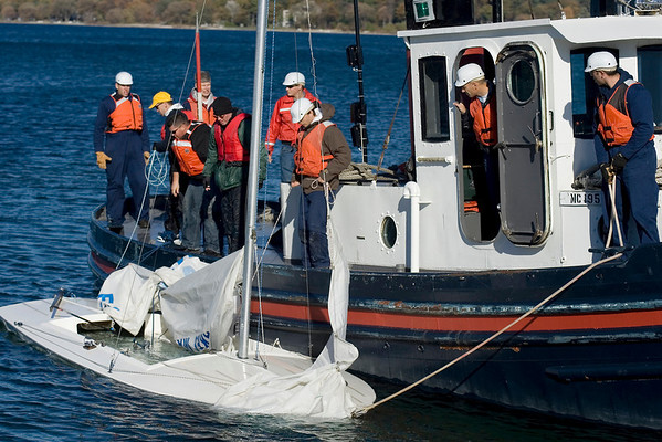 Record-Eagle/Keith King<br /> The Great Lakes Maritime Academy training vessel Anchor Bay, along with GLMA cadets and instructors, tows a GLMA sailboat toward shore in West Grand Traverse Bay Friday, October 22, 2010. There were no injuries.