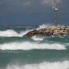 Record-Eagle/Jan-Michael Stump<br /> Wednesday's wind storms blow waves over the breakwall in Leland.