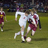 Record-Eagle/Keith King<br /> Suttons Bay's Garrett Bassett, left, and McBain Northern Michigan Christian's Kyle Benthem go after the ball Tuesday, October 26, 2010 at Suttons Bay High School.