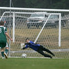 Record-Eagle/Keith King<br /> Traverse City West's Ben Casciano dives to deflect a Midland Dow shot.
