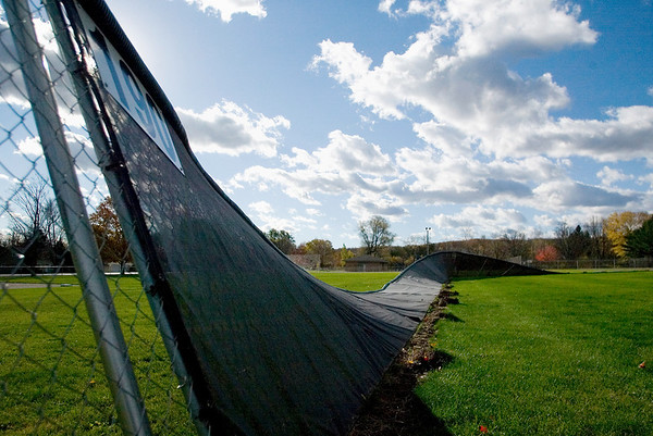 Record-Eagle/Jan-Michael Stump<br /> Wednesday's wind storms blew down the outfield fence at Elmwood Township's Cherry Bend Park.