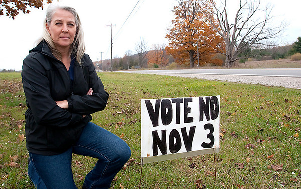 Record-Eagle/Douglas Tesner<br /> Cheryl Walton placed signs opposing a township millage off M-72 on Sunday, but she claims a zoning administrator pulled the signs this week.