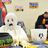 Record-Eagle/Vanessa McCray<br /> A ghost mans one of the game stations at Sunday's Halloween party at St. Mary-Hannah School in Kingsley.