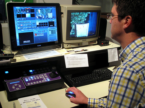 Record-Eagle/Alex Piazza<br /> Nate Jorgensen, of the Traverse City Area Chamber of Commerce, checks audio levels for an interview inside the production studio at the Land Information Access Association in Traverse City.
