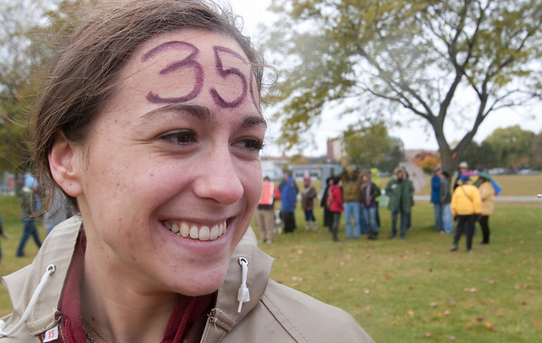 "Record-Eagle/Douglas Tesner<br /> Sarah Foltz attends the International Day of Climate Action event in Traverse City with ""350"" painted on her forehead."
