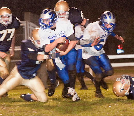Record-Eagle/Douglas Tesner<br /> St. Francis defensive end Luke Popp (2) stops an Inland Lakes ballcarrier.
