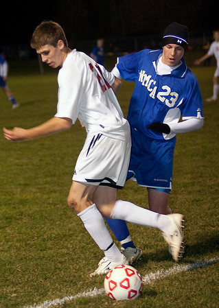 Record-Eagle/Douglas Tesner<br /> Suttons Bay junior Evan Glowicki (21) and Burt Lake NMCA's Paul Chatfield fight for the ball in Thursday's Division 4 regional.