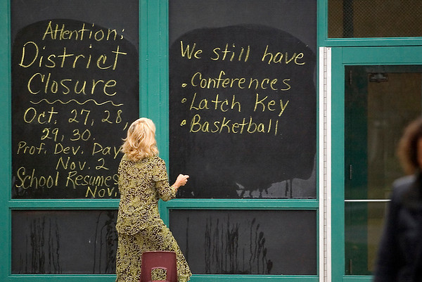 Record-Eagle/Jan-Michael Stump<br /> Eastern Elementary School third grade teacher Charma Brian changes the sign outside the school on Monday, shortly after TCAPS officials announced schools will be closed through Nov. 3 because of H1N1 flu concerns.