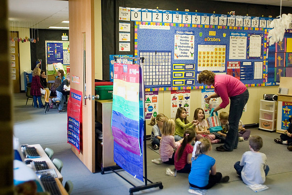 Record-Eagle/Jan-Michael Stump<br /> Angie Liestenfeltz, speech pathologist, does a Jump Start activity with students in Stephanie VanAlstine's class at Birch Street Elementary School in Kalkaska.