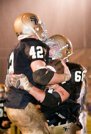 Record-Eagle/Douglas Tesner<br /> Gabe Gallagher (42) is hugged by teammate Peter Rigan after scoring on a 13-yard pass from Riley Bullough.