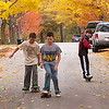 Record-Eagle/Douglas Tesner<br /> Nicky Schwert, left, Hayden Talbot, center, and Martin Foley, all fifth-graders at Central Grade School, skateboard down Fifth Street in Traverse City as schools were closed due to a flu outbreak.