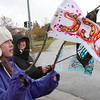 "Record-Eagle/Douglas Tesner<br /> Left, Clara Hahn, 12, and Majida Halaweh, 16, both from Benzie County, wave flags that have ""350"" on them for the International Day of Climate Action. Traverse City, participants gathered in the shape of ""350"" for a photograph and held other activities. They want the U.S. to return to 350 ppm of carbon dioxide in the atmosphere."