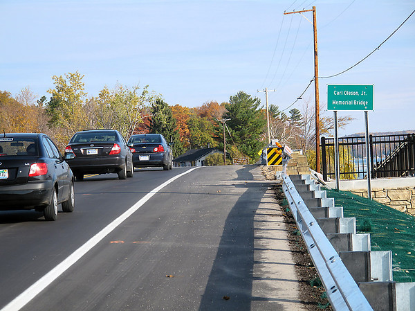 Record-Eagle/Alex Piazza<br /> Motorists drive across the Glen Lake Narrows Bridge in Glen Arbor. The bridge reopened Saturday after a $3.4 million construction project closed it last December.