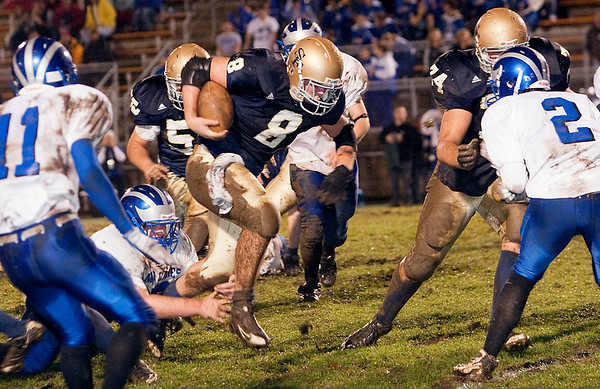 Record-Eagle/Douglas Tesner<br /> Traverse City St. Francis running back Joey Kerridge (8) works his way through the Inland Lakes defense as Bulldogs defenders Doug Elliott (11) and Garrett Gahn (2) pursue. The Gladiators won the first-round playoff game 54-0.