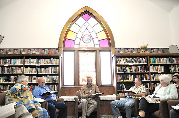 Record-Eagle/Vanessa McCray<br /> John Gleason, center,  pastor of Inland Baptist Church, leads a Bible discussion during a mid-week service in late September. The congregation is preparing to host the Touch of God Crusade from Oct. 11-28.