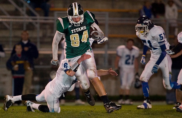 Record-Eagle/Jan-Michael Stump<br /> Petoskey defensive back Hunter Keiswetter (6) tackles Traverse City West tight end Jake Fisher in the first quarter of Friday's game.