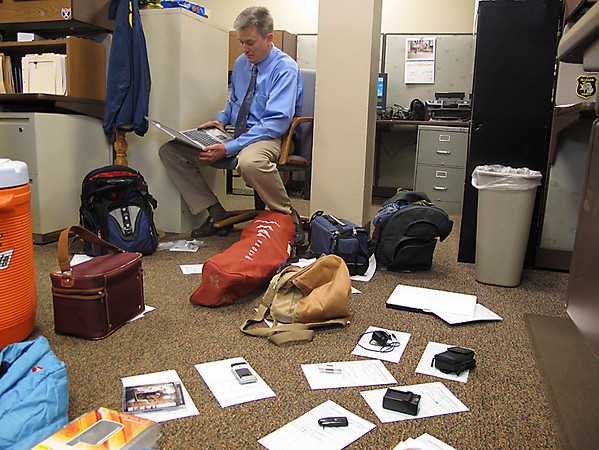 Record-Eagle/Art Bukowski<br /> Traverse City Police Department Capt. Brian Heffner reviews some of the items believed to be stolen from area vehicles.