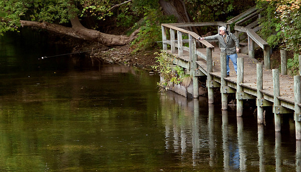 Record-Eagle/Douglas Tesner<br /> A lone fisherman enjoys the solitude on the Boardman River just below Union Street Bridge in Traverse City.