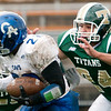 Record-Eagle/Douglas Tesner<br /> Traverse City West linebacker Dee Kirksey chases Kendre Powell.