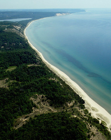 Record-Eagle/Jan-Michael Stump<br /> Lake Michigan looks placid in this aerial view of shoreline looking south from Frankfort, but the politics surrounding Great Lakes Basin issues are anything but that.