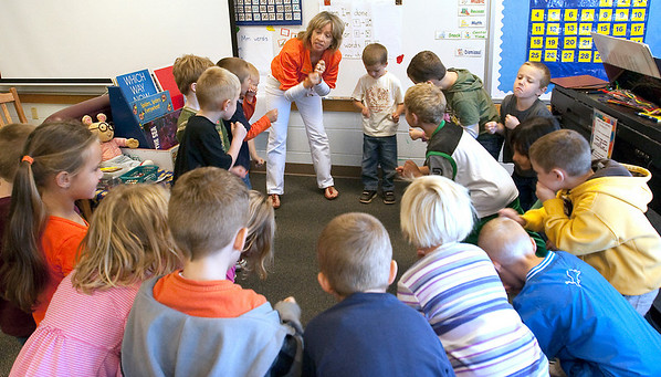 Record-Eagle/Douglas Tesner<br /> Music teacher Peggy Pierson works with a class of kindergartners at Blair Elementary School. Enrollment in all-day, every-day kindergarten at Blair increased rapidly right before school started this year.