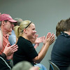 Record-Eagle/Jan-Michael Stump<br /> Laurie Mackowiak, center, and other supporters applaud after an anti-discrimination ordinance passed unanimously.