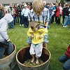 Record-Eagle/Keith King<br /> Michael Harris, 14, of Oxford, holds his brother, Brandon, 4, as his stepbrother, Devon King, right, 12, looks on Saturday during a wine stomping event, part of Harvest Day 2010 at Chateau Chantal on Old Mission Peninsula.