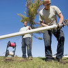 Record-Eagle/Keith King<br /> Justin Tighe, right, and Randy Borgen, employees with Traverse Outdoor, prepare to bury control wires and the main irrigation line.