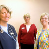 Record-Eagle/Jan-Michael Stump<br /> From left, Karen Comella, MaryPat Randall and Pat Light are all registered nurses who run a volunteer nursing triage at the Goodwill Inn. The triage allows residents of the inn to get medical screenings, have their medications reviewed and receive health education.