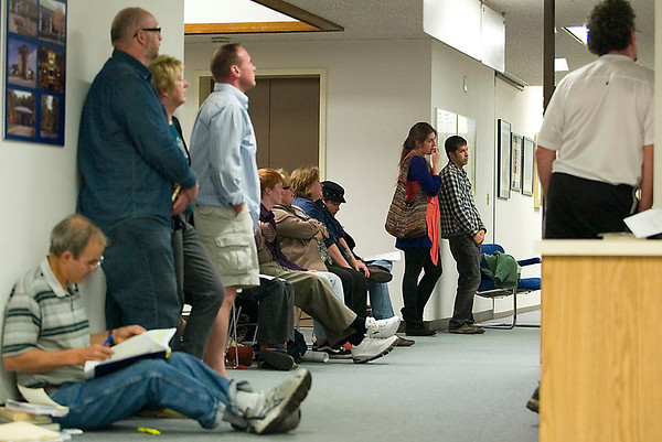 Record-Eagle/Jan-Michael Stump<br /> Overflow crowds wait in the hall outside the City Commission chambers Monday night. The Traverse City Commission unanimously passed an anti-discrimination ordinance at Monday night's meeting.