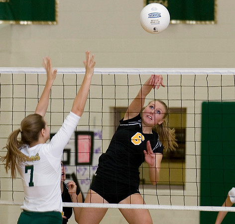 Record-Eagle/Keith King<br /> Traverse City Central's Brianna Podsaid hits the ball past Traverse City West's Anna Arnold in Wednesday's game.
